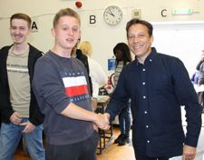 Mr guthrie head teacher of wilmington grammar school for boys congratulating student